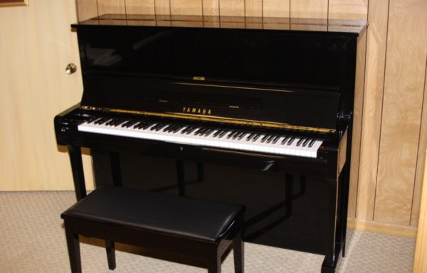 Two Yamaha Upright Studio Pianos